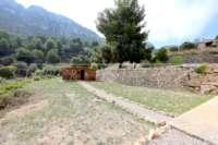 Finca moderna de fácil mantenimiento en ubicación panorámica privilegiada en Benimeli - Caseta de jardín