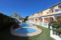 Adosado de 3 dormitorios céntrico con aire acondicionado y piscina comunitaria en Els Poblets - Jardín comunitario