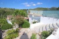 Soleado chalet con apartamento separado y piscina en Rafol d'Almunia - Jardín mediterráneo