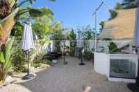 Farbenfrohes Ferienhaus unweit vom Meer und Ortskern in Els Poblets - Sommerküche