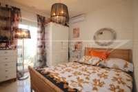 Farbenfrohes Ferienhaus unweit vom Meer und Ortskern in Els Poblets - Schlafzimmer