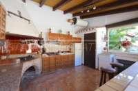 Finca clásica mediterránea en una ubicación privilegiada en Denia - Cocina de verano