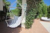 Bonito chalet de estilo casa de campo con piscina en urbanización exclusiva en Javea - hamaca