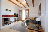 Bonita casa adosada de esquina con jardín privado cerca de la playa en Els Poblets - Salón
